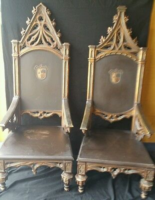 Pair of throne chairs Gothic his and hers knight family crest shield
