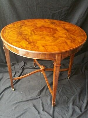 Center table English Edwardian style burld wood bronze casters Victorian era