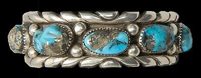 NAVAJO SILVER AND TURQUOISE CUFF BRACELET In the manner of silversmit... Lot 385