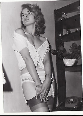 60`s   black and white  vintage amateur glamour  lady with shelving   photograph