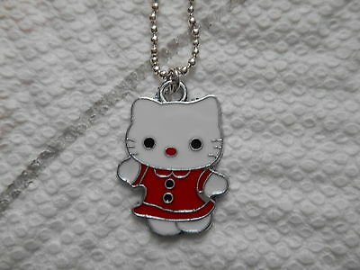 "Hello kitty, in a red dress, necklace, 20""silver plated chain"
