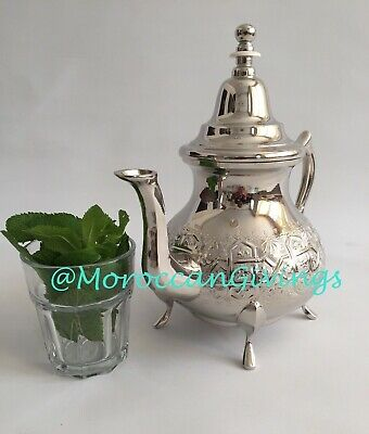 Authentic Moroccan handcrafted Alpaca Silver Qudsi Teapot from Fez .