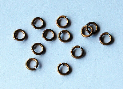 VINTAGE 12 RAW BRASS OPEN SPLIT JUMP RINGS 18 guage 5mm ONE DOZEN