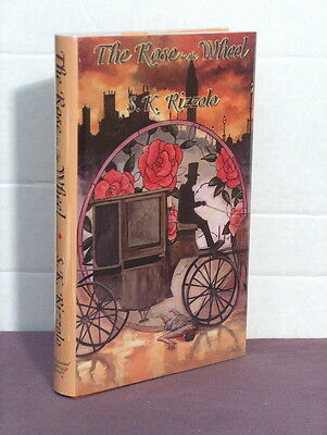 1st, signed by the author, The Rose in the Wheel by S K Rizzolo (2002)