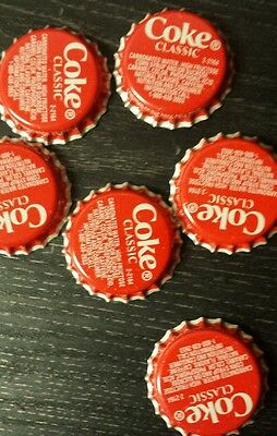 50  coke caps   new and unused