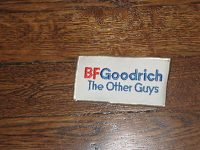"""BF GOODRICH""""THE OTHER GUYS""""60's patch, nos, red and blue letters,set of 2"""