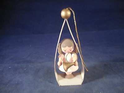 vintage angel playing french horn christmas ornament wood and cardboard germany