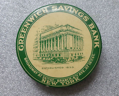 old celluloid dime bank advertising Greenwich Savings Bank