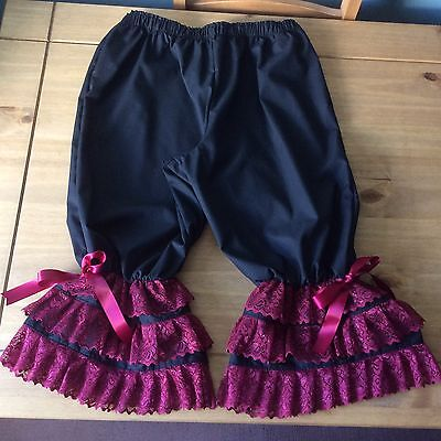Black bloomers edged with 3 rows of burgundy lace