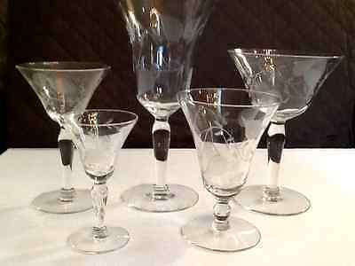 An extensive set of engraved glass stemware 48 total pieces