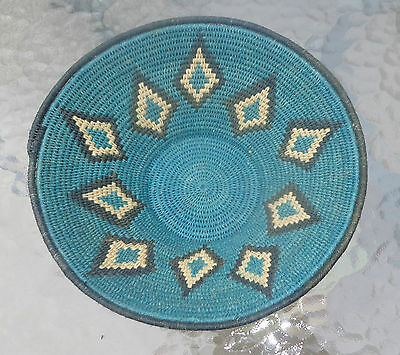 fine African coiled basket teal diamond points