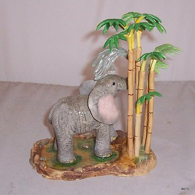 Country Artists Tuskers - Summer Shower Model No CA02990