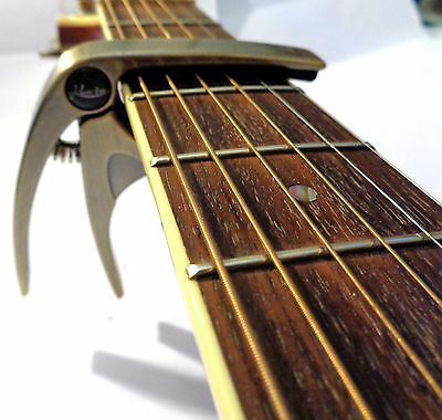 ROWIN CAPO–QUICK RELEASE TRIGGER for ACOUSTIC-ELECTRIC GUITAR & UKUELE in BRONZE