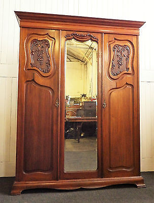 Antique large Victorian french style carved walnut double door wardrobe