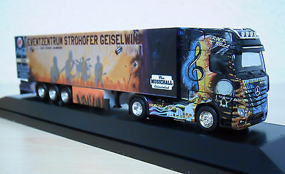"""Herpa - MB Actros `11 """"Wolf Transp. / Autohof Strohofer"""" PC-Modell 121651 -1:87"""