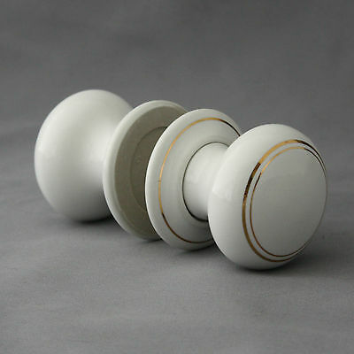 Pair of White Ceramic Door Knobs With Gold Trim
