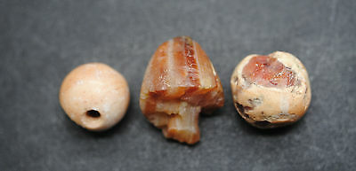 Three Ancient Egyptian Carnelian Carved And Polished Beads, Middle Kingdom.