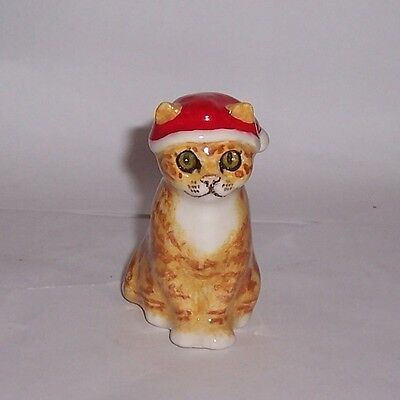 Winstanley Size E Ginger Cat sittiing wearing Christmas hat