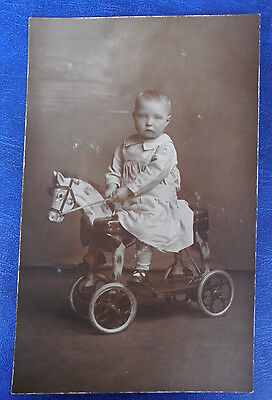 Young Boy on antique toy Horse. Edwardian Real Photograph Postcard.
