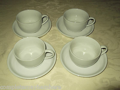 Set of 4 White ceramic Coffee / Tea cups & saucers