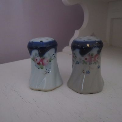Pair of antique salt & pepper shakers flow blue with hand painted pink roses