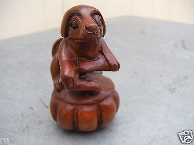 China Carved Boxwood Statue of Dog on pumpkin