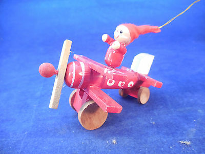 "Vintage Wooden Pixie In Airplane 3 1/4"" Long"