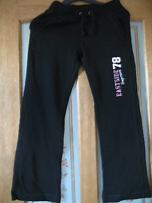 Girls Marks and Spencer black straight leg jogging trousers in age 11 years
