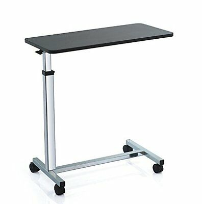 Over bed table with 4 castors and height adjustable top - raises with 1 finger