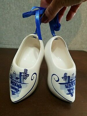 Pair of DELFT BLUE ceramic Dutch Shoes white/blue w/blue ribbon and crazing