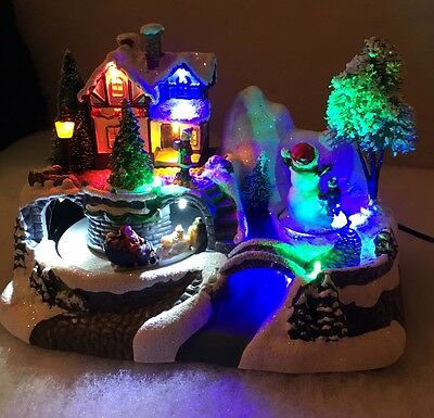 LED 23cm Festive Christmas Animated Village Decoration Moving Sleigh & Snowman
