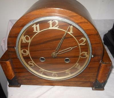 walnut cased striking mantel clock