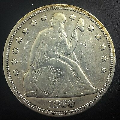 1869 Seated Liberty Silver Dollar  Mid Grade