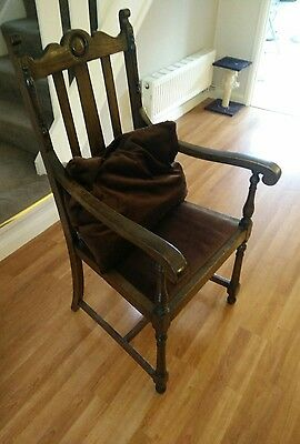Solid oak, early 20th century chair with arms. Antique, retro, vintage
