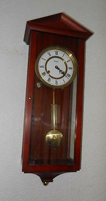 vienna style modern mahogany striking wall clock by rapport