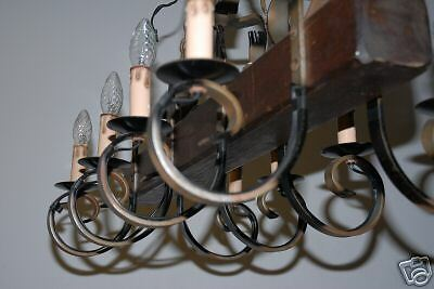 A Wooden/Wrought-Iron 8 Light Castle Chandelier