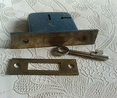 Vintage blue lever lock with key and plate