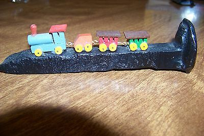 Decorative small train on Black Railroad Spike Vintage