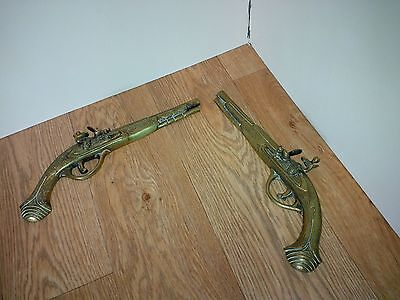 A pair of vintage Brass Musket wall ornaments.