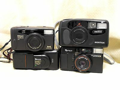 Four (4) 35mm Auto Focus Point and Shoot Cameras