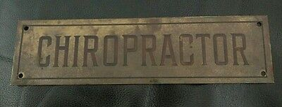 Vintage brass chiropractor name plate