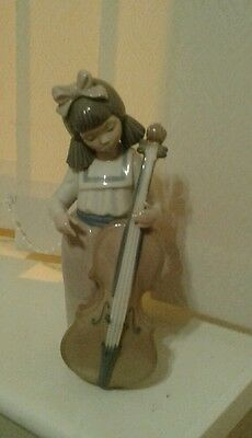nao figurines girl playing a cello