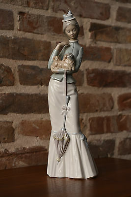 Lladro 4983 - lady with parasol holding a pekinese