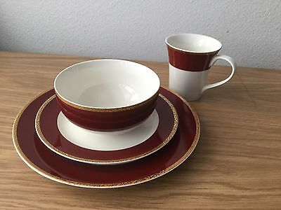 Holiday 09 Classic Tidings Dinnerware Set 16 PC Red & Gold Trim