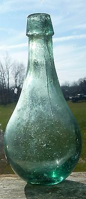 Very old green Glass bottle. Date unknown 1840 - 1860? Very small star crack