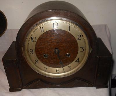 oak cased striking mantel clock