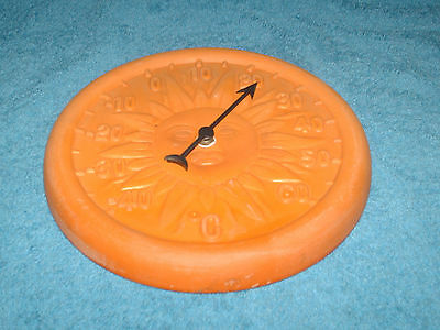 a orange earthenware sundial thermometer 21 cm round
