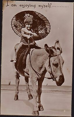 CHRISTMAS PRESENT? POSTCARD OF A CHILD ON A DONKEY. Circa 1910