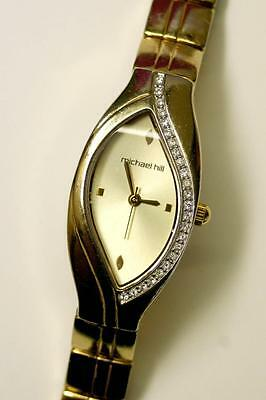 MICHAEL HILL LADIES DRESS GOLD-TONNED WATCH with Crystals - Used with some wear