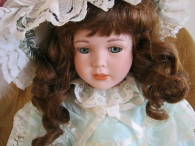Porcelain Doll in Period Costume on Stand
